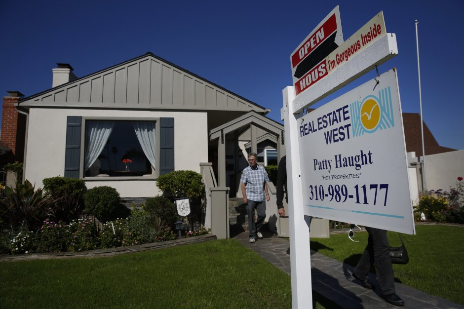 Potential home buyers exit an open house in Redondo Beach, Calif.