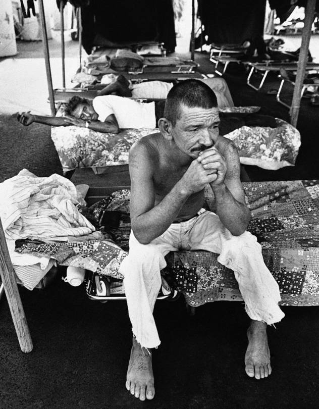 A Cuban refugee rests on his cot in Miami's 'tent city,' Aug. 18, 1980. At the time, five out of every six working-age Cuban refugees in Florida's Dade County were without a job.