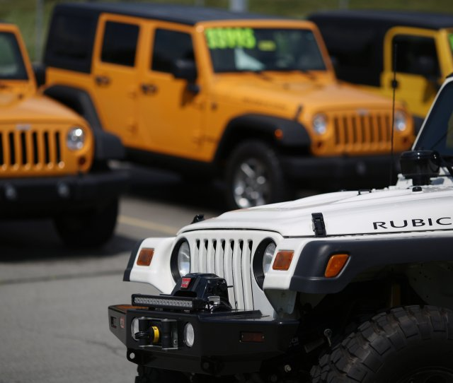 Jeep Wrangler Rubicon Vehicles Are Displayed For Sale At The Cross Chrysler Jeep Dealership In Louisville