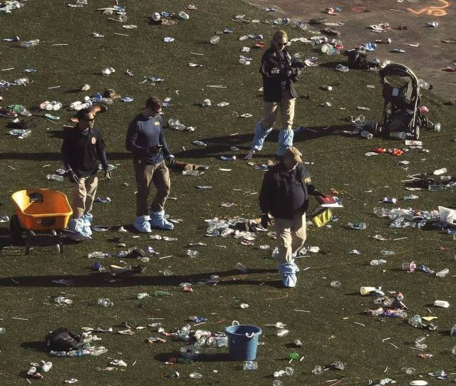 Investigators Work Among Thousands Of Personal Items At A Festival Grounds Across The Street From The