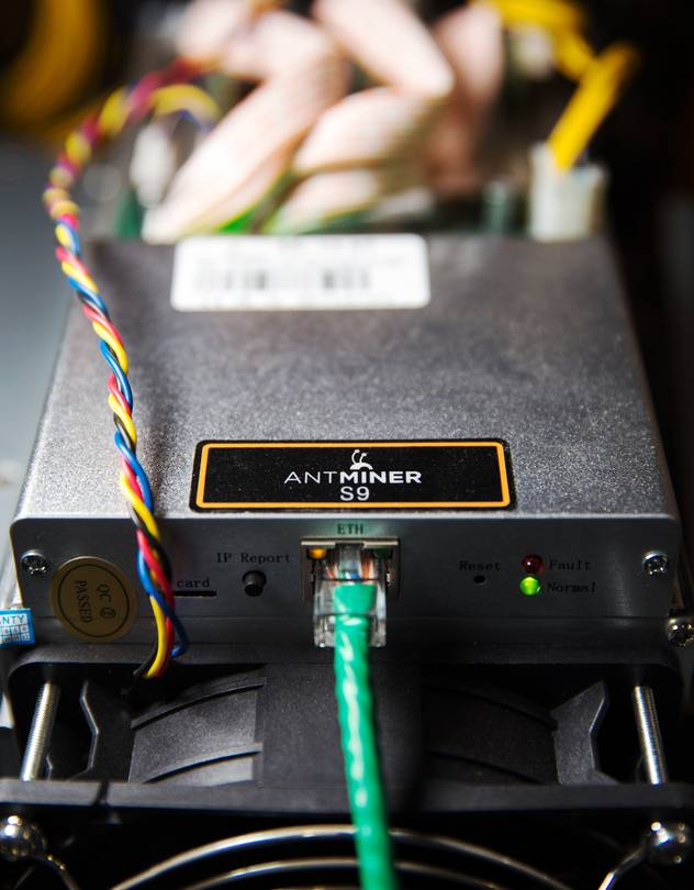 A Bitmain Antminer S9 computer specifically designed to mine bitcoins.