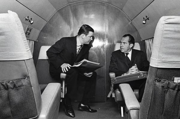 The author and Nixon on a plane in 1968.