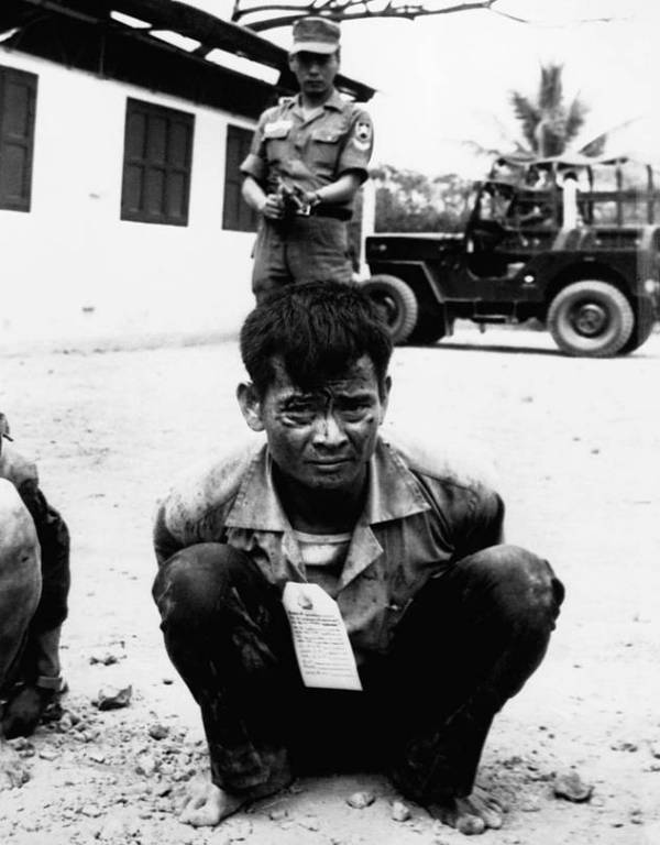 The Tet Offensive was seen as a major American setback in 1968 but the Viet Cong lost huge numbers of troops; above, a Viet Cong soldier awaits interrogation following capture.