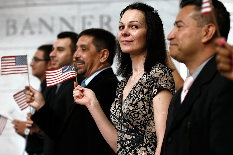 Newly naturalized U.S. citizens celebrate after taking the oath of citizenship in Washington, D.C., June 17.