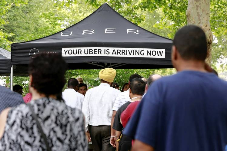 Lining up in Queens, N.Y., to register as Uber drivers, July 21.