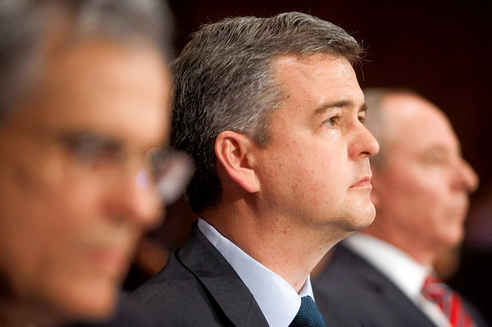 SEC Commissioner Daniel Gallagher, center, said the rules could sow a repeat of the financial crisis.