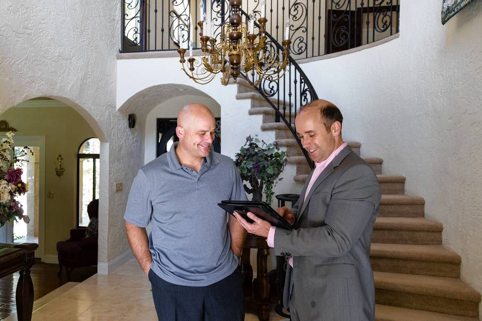 Jon Hoefling, left, with his listing agent Brett Jennings in Mr. Hoefling's home in Morgan Hill, Calif. Jason Henry for The Wall Street Journal