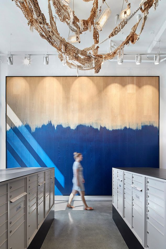 One of two mailrooms at the Abaca rental building in San Francisco. A custom-designed sculptural chandelier is made from abaca, the fiber used to make rope in the factory that once stood at the site.