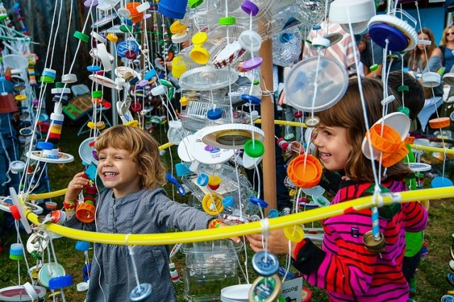 A Girl Enjoys The Trash Tree At The Third Annual New York World Maker