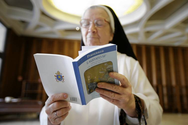 A nun read Pope Francis' new encyclical at the Vatican on Thursday, the day it was published.