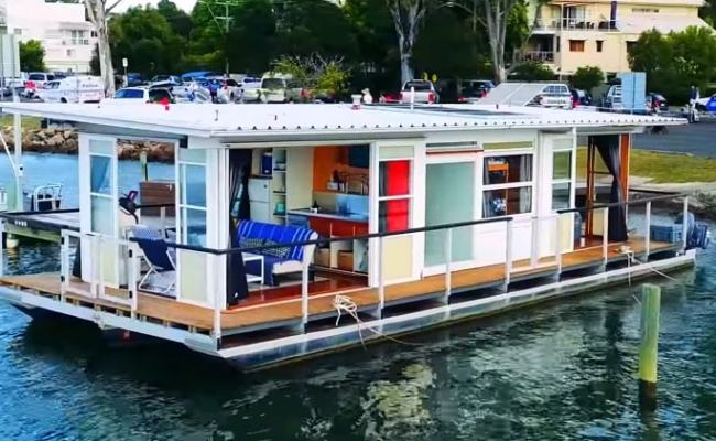 Life On The Water In A Tiny Floating House Boat