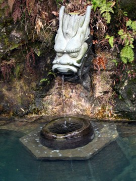 Dragon head spitting water at original Long Jing Dragonwell in Hangzhou, Zhejiang province, China