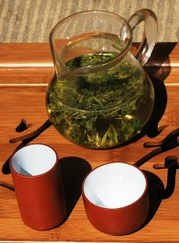 Preparing Long Jing Dragonwell Green Tea in a glass teapo