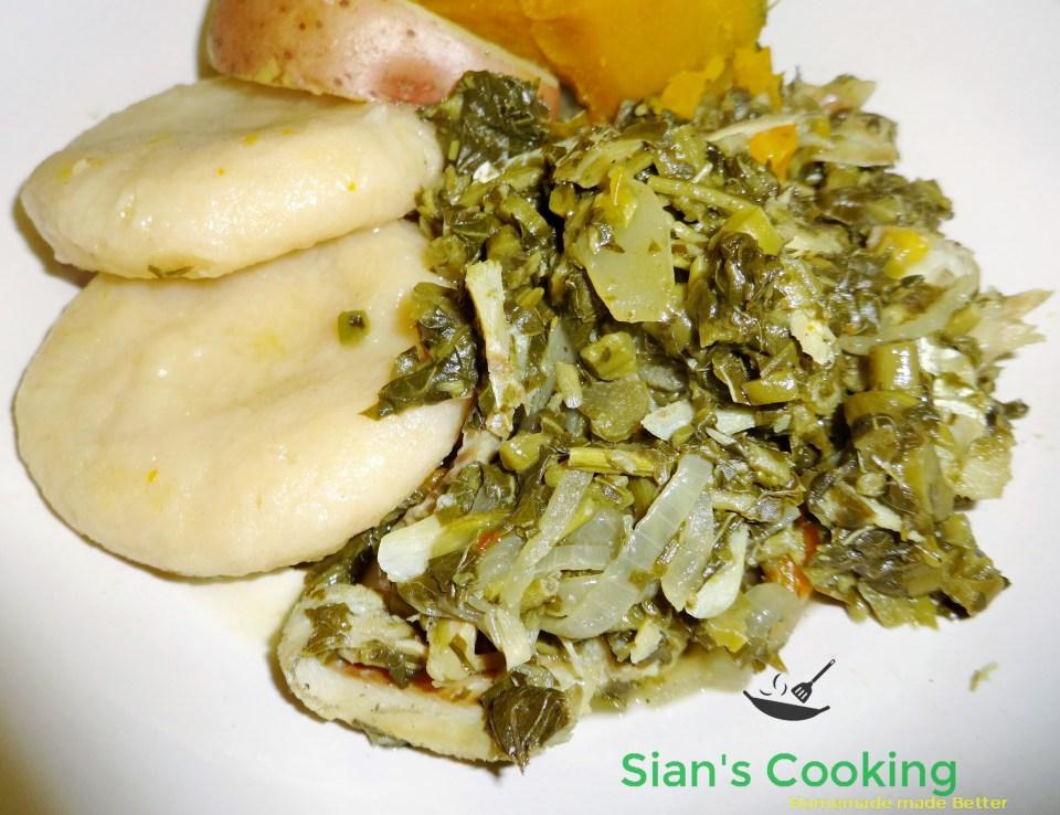boiled cornmeal dumpling with saltfish and callaloo