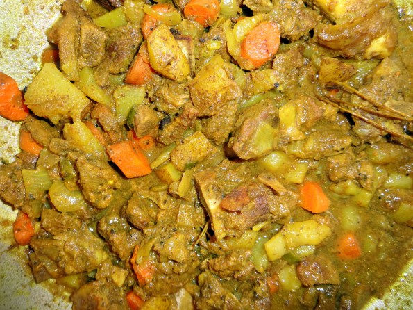 cooking curry goat