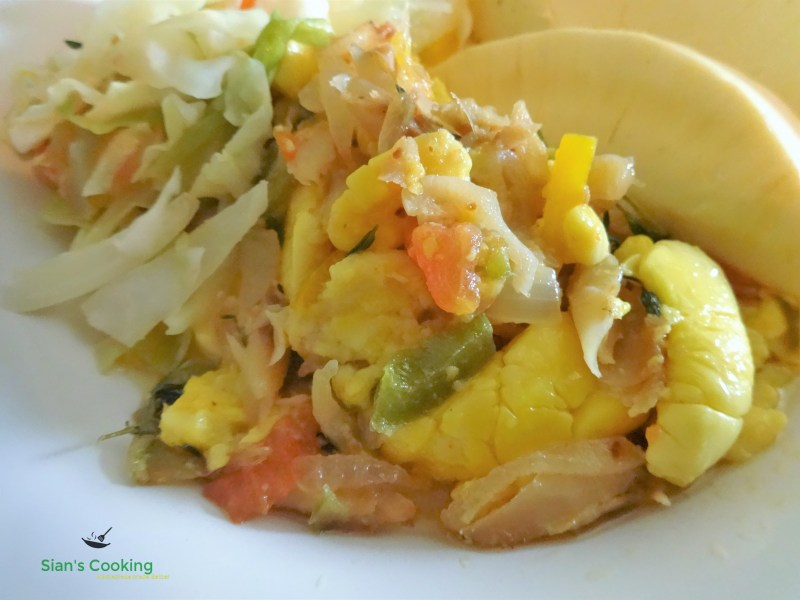 Ackee & Saltfish with Roast breadfruit and steamed cabbage