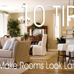 Decorating Ideas To Make A Small Living Room Look Bigger Modern Chair And Ottoman How Rooms Larger Sibcy Cline Blog
