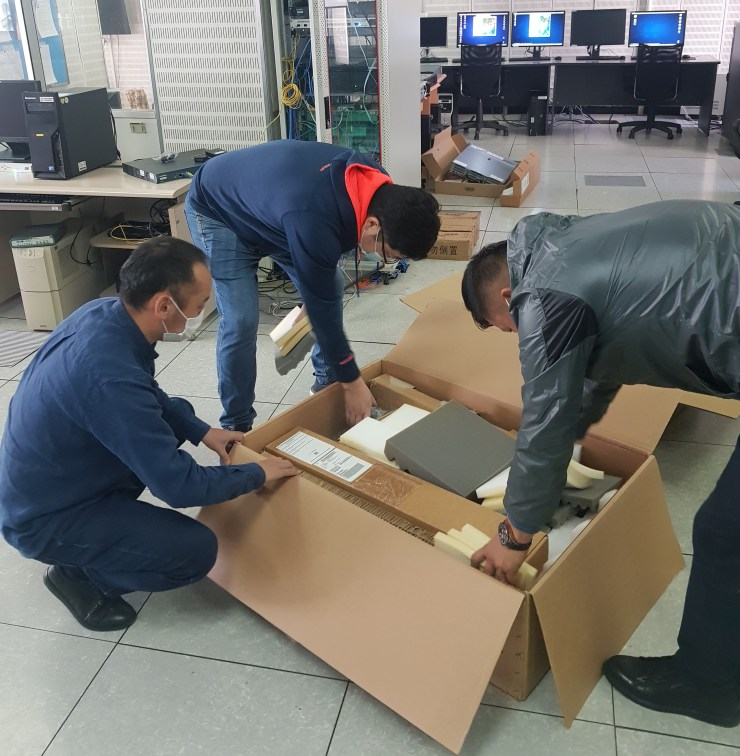 Staff from NAMEM opening the boxes containing the Mongolian Data Cube.
