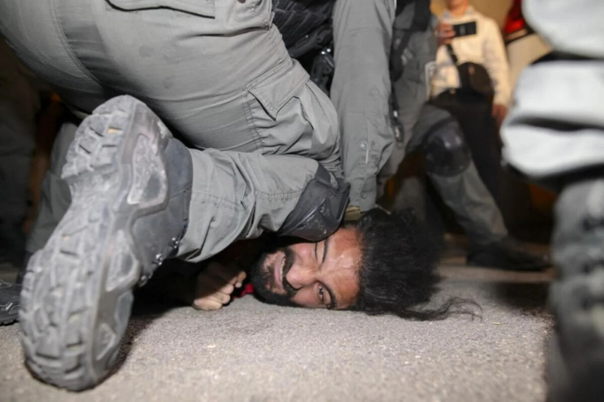 Israeli forces detain a man during storming PalesFacing Evection