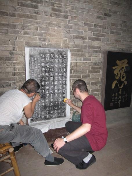 Laojun Shan Making a Rubbing of the Stele Inscription by Yan Kai (1919) in 2009