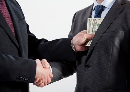 Image of a bribe taking place - bribery is a key corruption offense