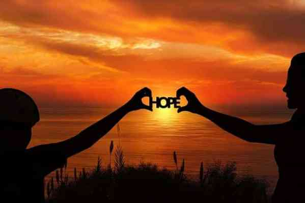 Sunset with hands holding up Hope