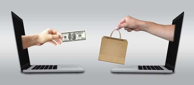 online shopping laptops exchanging money for gift bag