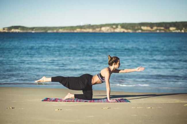 Side Jam Interview - Teaching Exercise Class - Woman doing Yoga on the Beach