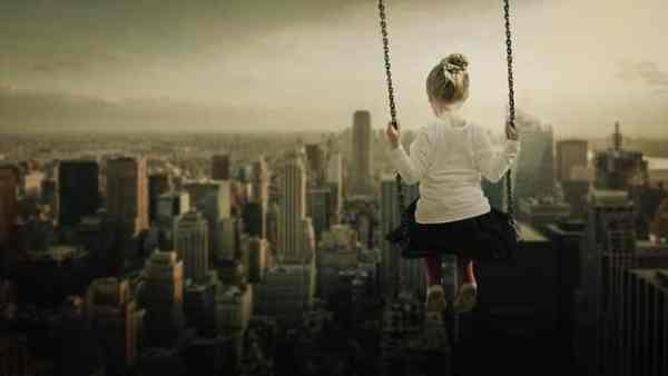 vintage skyline with little girl on a swing