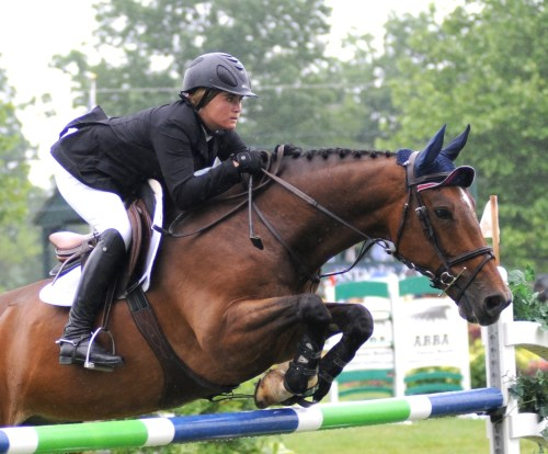 Don Juan does hunters and grand prix jumpers, shown here with Tori in the first round of the 2013 Upperville Jumper Classic. Photo By Lauren R. Giannini