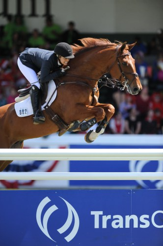 """Ashley and Cadette 7 at Spruce Meadows. """"I hold Spruce Meadows very dear to my heart. It's where Cadett and I started and won our first Grand Prix together,"""" Ashlee said.  Photo by Mike Sturk and Spruce Meadows Media"""