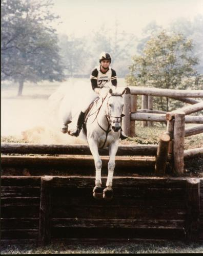 """Gray and Kim jumping the Lexington Bank during the filming of the movie, Sylvester. """"The movie was shot during the summer of 1984, and I was asked to do the double work for Melissa Gilbert for the filming done at the Kentucky Horse Park,"""" Kim said. """"Wherever you don't see Melissa's face, it's me. Gray did all the shots where the cameraman hid inside the jump and filmed the horse going over. Gray was so careful in those instances!"""" Photo by Mary Phelps"""