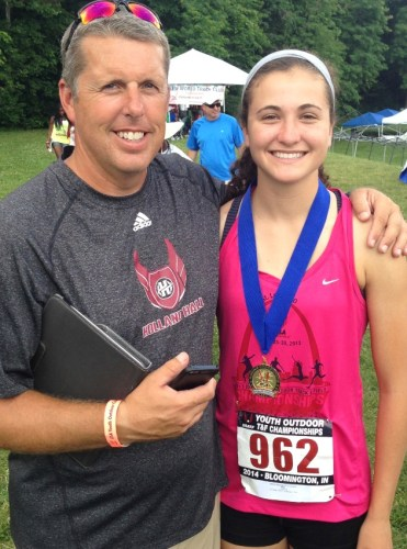 Lizzie with her coach Brian Thompson after winning the USATF Youth National Championship.