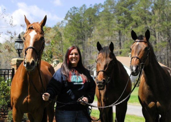 Kimmy's college graduation photo with, left to right, Cam, Miller and Levi. Instead of graduation gifts, Kimmy asked that people donate to an animal rescue. Photo by Danielle Calore