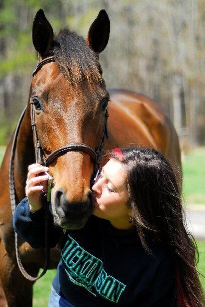 Kimmy and her junior show hunter, and horse of a lifetime, Make My Day. Photo by Danielle Calore
