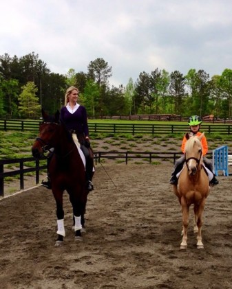 Stephanie's son, Connor, rides beside her and Clever on his pony, Maple. Photo courtesy of Stephanie Hartigan