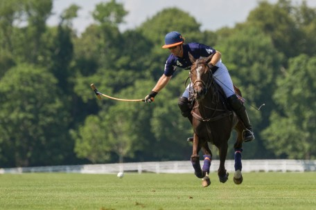 Kris and his pony catch some air as they race after the ball. Photo by Katerina Morgan