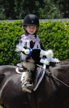 A young rider enjoys the Menlo Charity Horse Show. Photo by Drew Altizer
