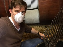 Timothy looks prepared as he tackles cleaning a stall — an activity that a horse hubby often has to undertake.