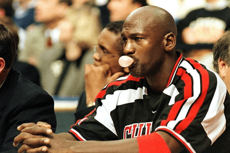 CLEVELAND, OH - NOVEMBER 11: Chicago Bulls guard Michael Jordan watches the final minutes of the fourth quarter of the game against the Cleveland Cavaliers from the bench 11 November at Gund Arena in Cleveland, OH. The Cavaliers held Jordan to 19 points and six rebounds as they defeated the Bulls, 101-80