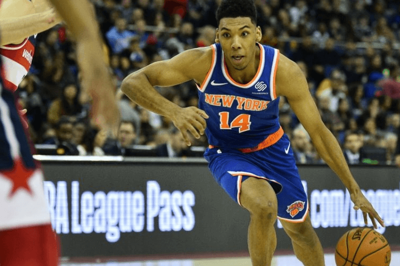 New York Knicks' Allonzo Trier (R) dribbles the ball during the NBA London Game 2019 basketball game between Washington Wizards and New York Knicks at the O2 Arena in London on January 17, 2019.