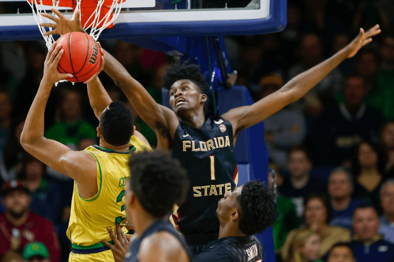 SOUTH BEND, IN - FEBRUARY 11: Jonathan Isaac #1 of the Florida State Seminoles reaches for the shot put up by Bonzie Colson #35 of the Notre Dame Fighting Irish at Purcell Pavilion on February 11, 2017 in South Bend, Indiana. Notre Dame defeated Florida State 84-72