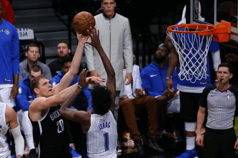NEW YORK, UNITED STATES - OCTOBER 21: Timofey Mozgov of Brooklyn Nets in action against Jonathan Isaac of Orlando Magic during NBA basketball match between Brooklyn Nets and Orlando Magic in Barclays Center in Brooklyn borough of New York , United States on October 21, 2017.