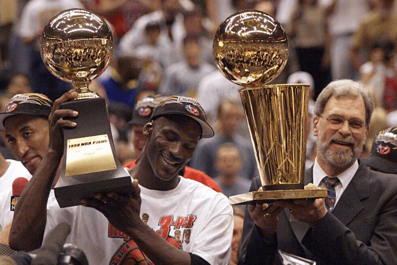 Michael Jordan and Phil Jackson celebrate after finishing off the Jazz to win the 1998 championship. 2020-04-16 Jordan Jackson