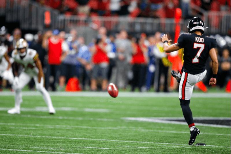 ATLANTA, GA - NOVEMBER 28: Younghoe Koo #7 of the Atlanta Falcons kicks an onside kick during the second half of an NFL game against the New Orleans Saints at Mercedes-Benz Stadium on November 28, 2019 in Atlanta, Georgia.