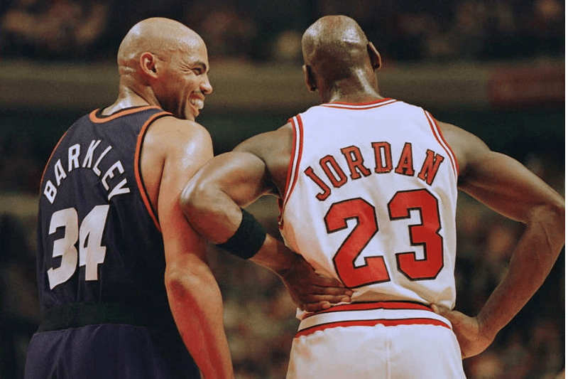 CHICAGO, IL - JANUARY 28: Phoenix Suns forward Charles Barkley (34) laughs at a foul call with Chicago Bulls guard Michael Jordan (23) in the first half 28 January 1996 at the United Center in Chicago. The Bulls won 93-82. Jordan scored 31 points, and Barkley scored 20 with 16 rebounds.