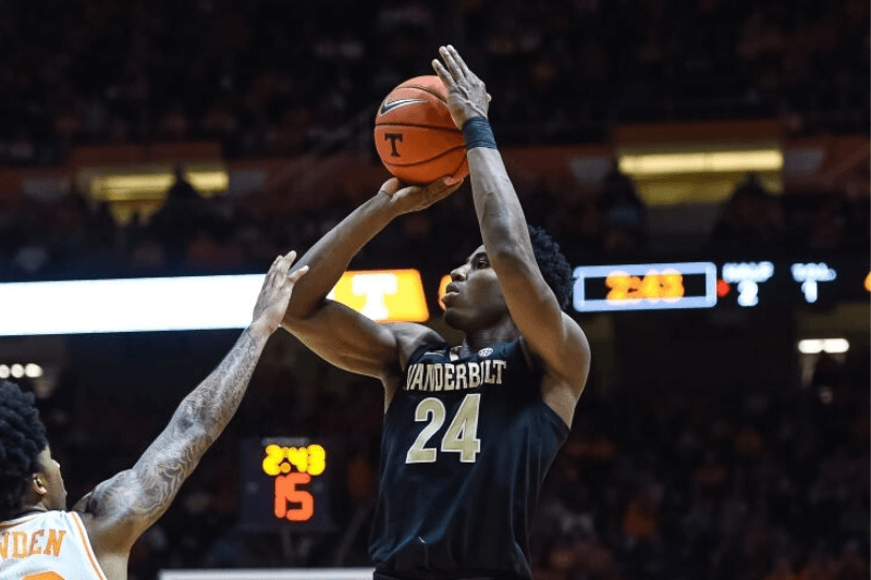 KNOXVILLE, TN - FEBRUARY 19: Vanderbilt Commodores forward Aaron Nesmith (24) takes a shot over Tennessee Volunteers guard Jordan Bowden (23) during a college basketball game between the Tennessee Volunteers and Vanderbilt Commodores on February 19, 2019, at Thompson-Boling Arena in Knoxville, TN.