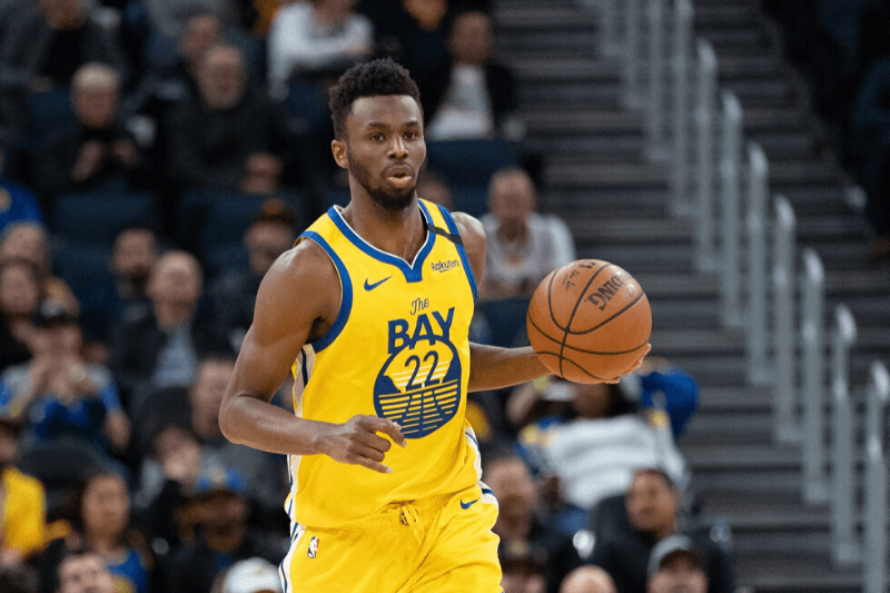 March 1, 2020; San Francisco, California, USA; Golden State Warriors guard Andrew Wiggins (22) dribbles the basketball during the fourth quarter against the Washington Wizards at Chase Center.