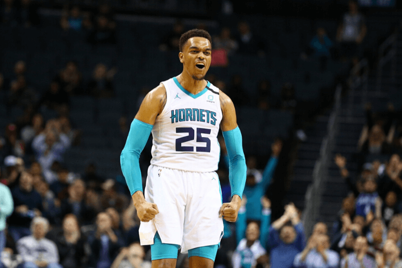 Mar 3, 2020; Charlotte, North Carolina, USA; Charlotte Hornets forward PJ Washington (25) reacts after a three point basket against the San Antonio Spurs at Spectrum Center.
