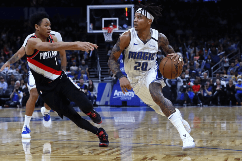 Mar 2, 2020; Orlando, Florida, USA; Orlando Magic guard Markelle Fultz (20) drives to the basket as Portland Trail Blazers guard Anfernee Simons (1) defends during the second half at Amway Center